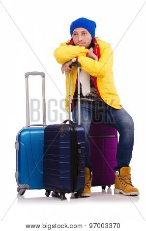 Tourist sitting on suitcase isolated on white