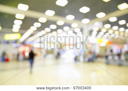 Hall with duty free shops in airport out of focus - defocused blurred background