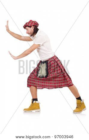 Man in scottish skirt isolated on white