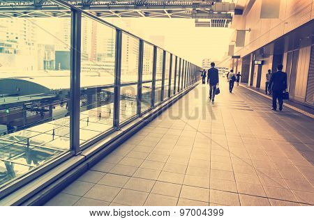 Business Men Walking Inside A Train Station