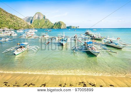 Front Beach With Longtail Boats In El Nido - Beautiful Tropical Destination In Palawan Philippines