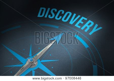 The word discovery and compass against grey