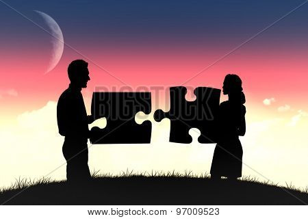 Businessman talking against magical sky