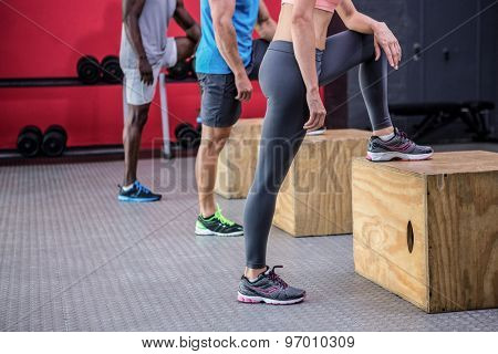 Three young Bodybuilders doing exercises in the  gym