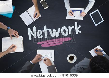 The word network and business meeting against blackboard