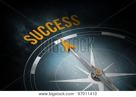 The word success and compass against dark background