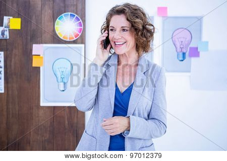 Creative businesswoman having phone call in office