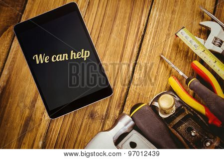 The word we can help and tablet pc against desk with tools