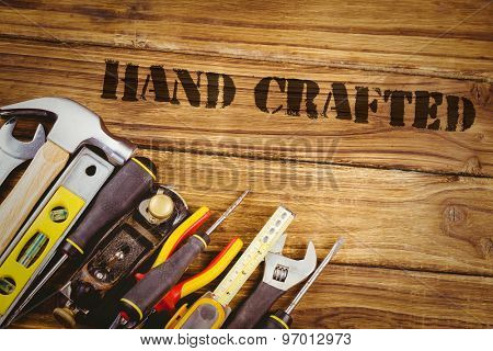 The word hand crafted against tools on desk