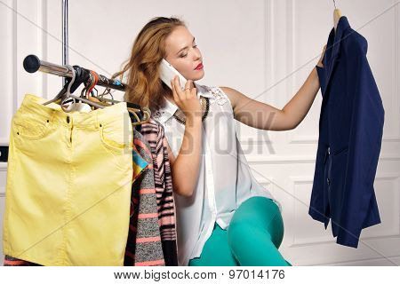 Woman Chooses Jacket In The Store