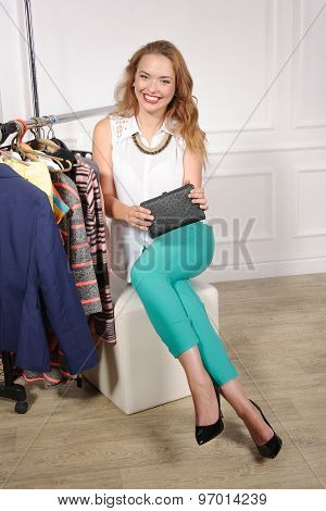 Woman In A Clothing Store Showing Her Purse