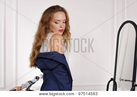 Girl In A Clothing Store Trying On A Jacket