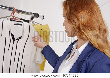 Girl Chooses Male Shirt In A Clothing Store
