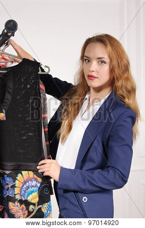 Woman In Formal Wear Chooses Black Shirt