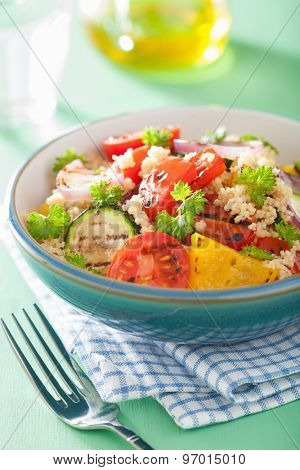healthy couscous salad with tomato pepper zucchini onion