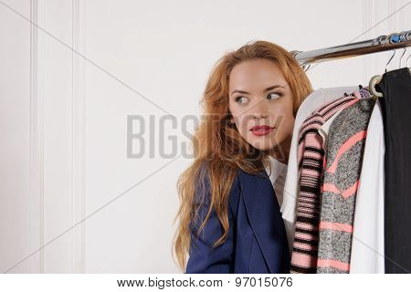 Woman In Formal Clothes Hiding Behind The Counter