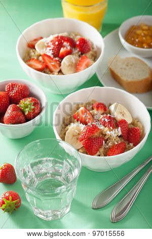 healthy breakfast quinoa with strawberry banana coconut flakes