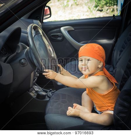 Cute baby sitting in a car
