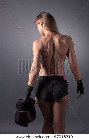 Women From Behind Holding Boxing Gloves