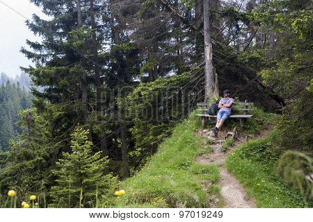 Hiker Takes A Break And Enjoys The View