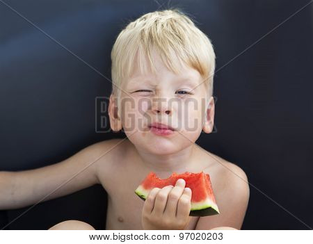 Infant eats a watermelon