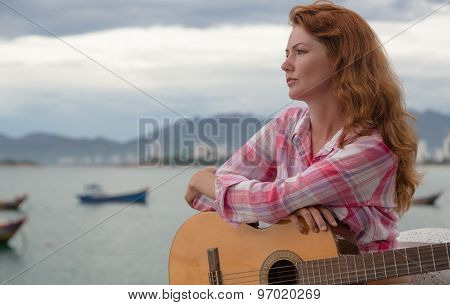Beautiful Red-haired Girl With A Guitar