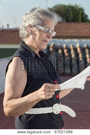 Senior Woman Hanging Out The Washing