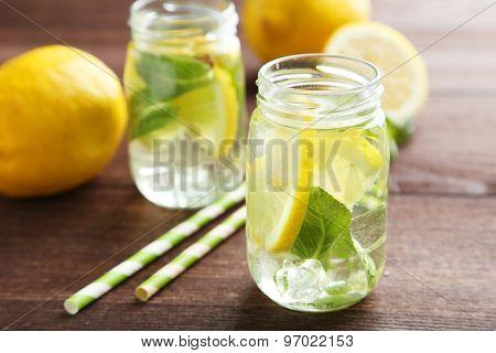 Fresh Lemonade With Lemon On Brown Wooden Background
