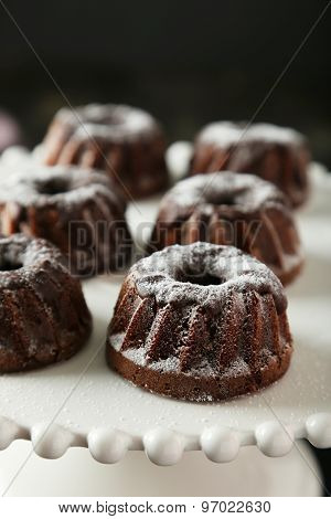 Chocolate Bundt Cakes On Cake Stand On Black Background