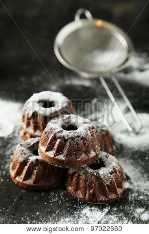Chocolate Bundt Cakes With Icing Sugar On Black Background