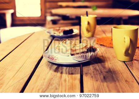 Rolls And Coffee Cups On A Wooden Table