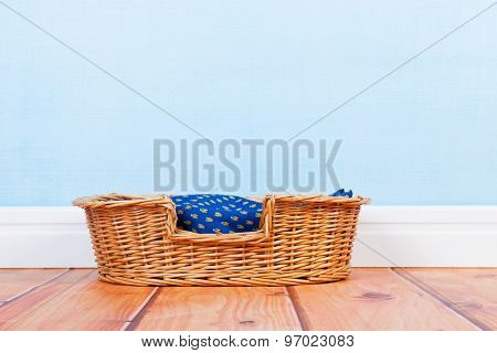 Empty basket at the floor for dog or cat