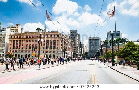 SAO PAULO, BRAZIL - APRIL 17, 2015: People walk in Santa Ifigenia viaduct on April 17, 2015 in Sao Paulo, Brazil. Santa Ifigenia is located in downtown with exclusive use for pedestrians.