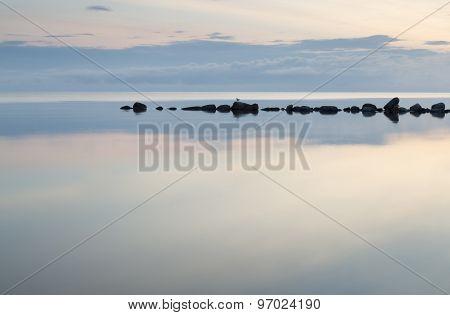 Breakwater Rocks In Calm Sea
