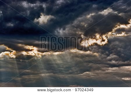 Stormy Sky With A Dramatic Sunbeams