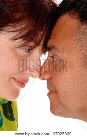 Middle Age Couple With Forehead Together.