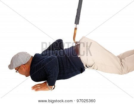 Man Lying On Floor Pulled Up With Umbrella.