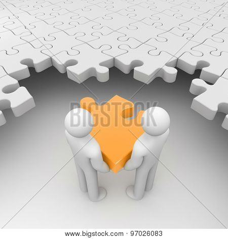 Two persons holding orange puzzle surrounded by white puzzles