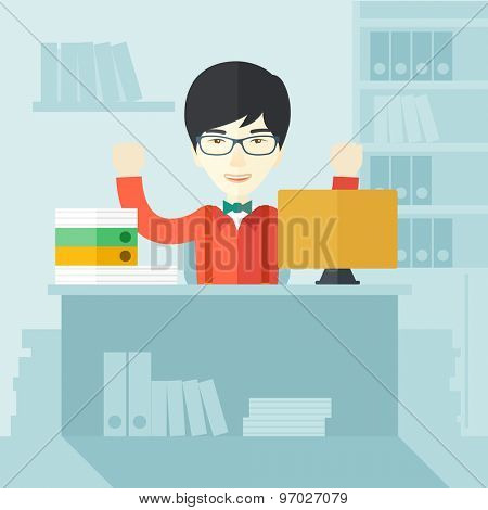 A very happy chinese businessman sitting while raising his both hand finished his work with laptop and paper works on time inside his office. Achievement concept. A Contemporary style with pastel