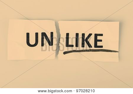 The word unlike changed to like on torn paper and white background