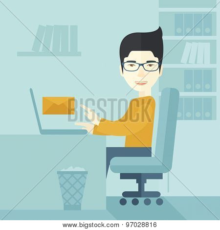 Young happy japanese man sitting in front of a table with computer laptop and thinking what to write in e-mail inside his office. A Contemporary style with pastel palette, soft blue tinted background