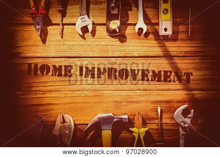 The word home improvement against desk with tools