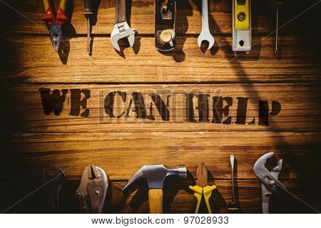 The word we can help against desk with tools
