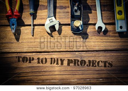 The word top 10 diy projects against desk with tools