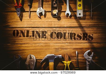 The word online courses against desk with tools