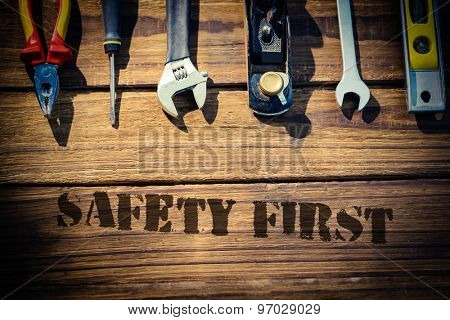 The word safety first against desk with tools