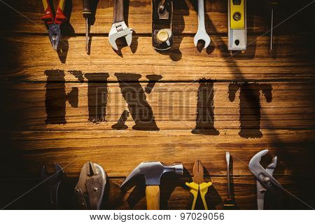 The word fix it against desk with tools