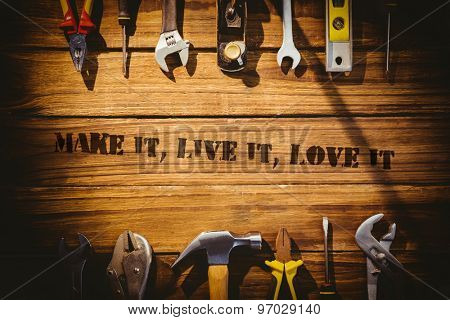 The word make it, live it, love it against desk with tools