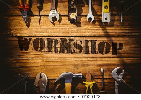 The word workshop against desk with tools