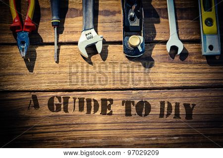 The word a guide to diy against desk with tools